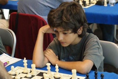 A young boy in full concentration