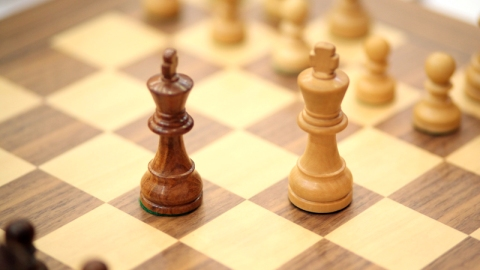 Playing Black Emirhan Tarlabasi won the game without making any move against Russian chess player Daniil Golikov. His opponent didn't come in time and lost due to zero tolerance rule. That game between the two leaders was played in the first board.