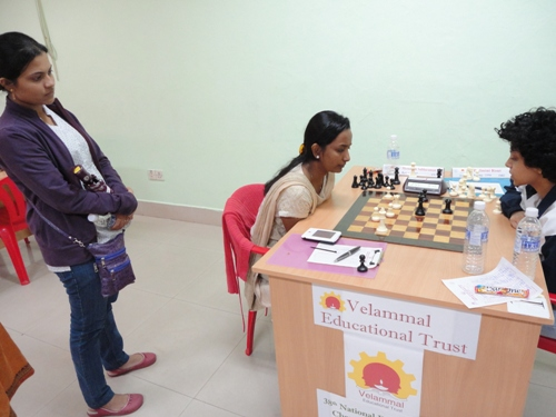 WIM Bhakti Kulkarni watching the marathon top board game between WGMs Meenakshi Subbaraman & Padmini Rout