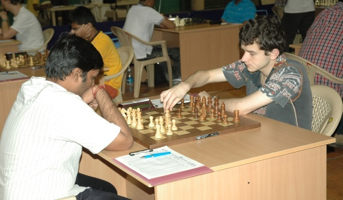 Defending champion GM Kravtsiv Martyn (Ukraine) making his move against T U Navin Kanna (India)