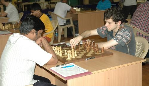 Defending champion GM Kravtsiv Martyn (Ukraine) making his move against T U Navin Kanna (India)