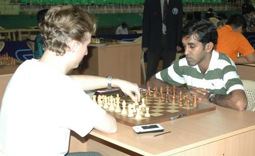 Grandmaster Oleksienko Mikhailo (Ukraine) facing International Master M S Thejkumar (India)
