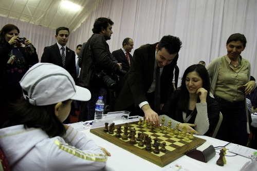 The officials of the Turkish Chess Federation make the symbolic opening moves