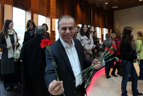 Ali Nihat Yazici presents flowers to the ladies