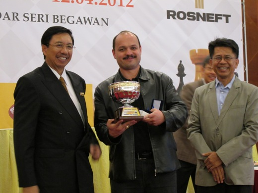 GM Marat Dzhumaev receiving trophy