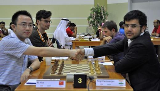 Ni Hua and Negi Parimarjan starting the game