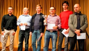 From the left: GM Yuri Solodovnichenko, Ukraine, GM Ramil Hasangatin, Russia, IM Timofey Galinskyi, Ukraine, GM Vladimir Georgiev, Macedonia with the trophy, GM Gabriel del Rio and GM Marc Narciso Dublan, both Spain.