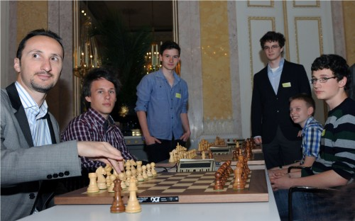 Topalov surrounded by Austrian juniors, including Martin Christian Huber, 13, who beat him (second from right) and Hungary's Kristof Juhasz (third from right)