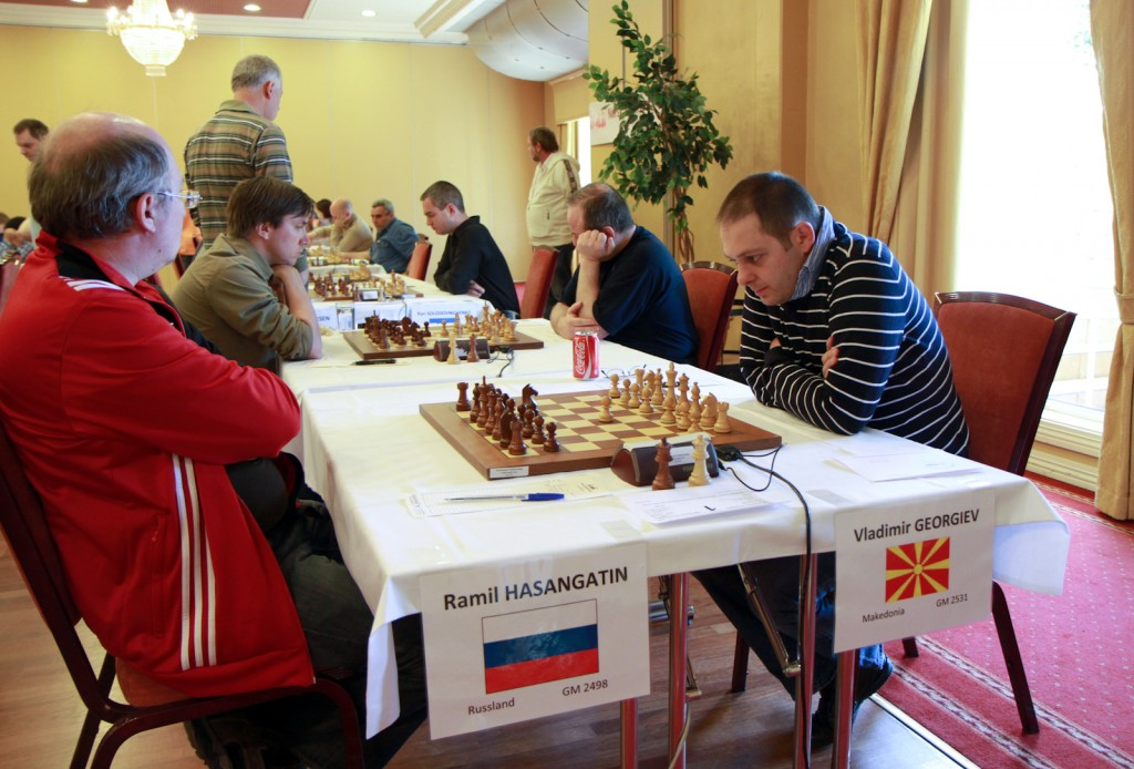 The central game of the round in tornament A: GM Vladimir Georgiev of Macedonia against GM Ramil Hasangatin of Russia.
