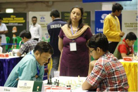 WIM Saheli Dhar Barua, watching her husband GM Dibuendu Barua in action against young Praneeth Surya