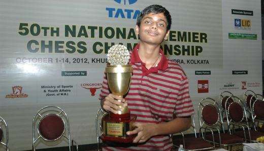 G Akash with winner's trophy
