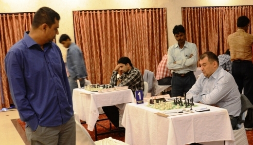 Top seed Aleksej of Belarus on deep thoughts, opponent Ziaur Rahman of Bangladesh is watching
