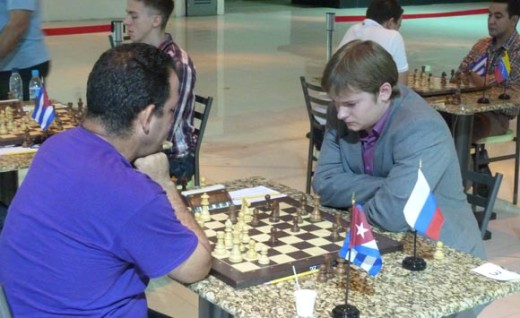 FM Ravelo Gil Eddy from Cuba held the Russian GM Papin Vasily to a draw
