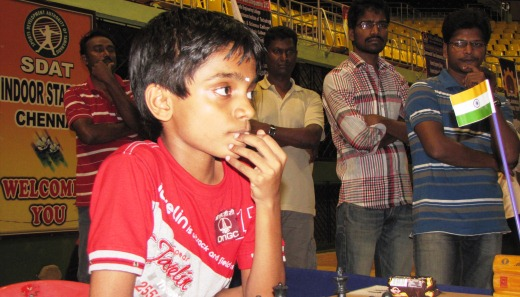 Admirers watch young FIDE Master V R Aravindh Chithambaram in action