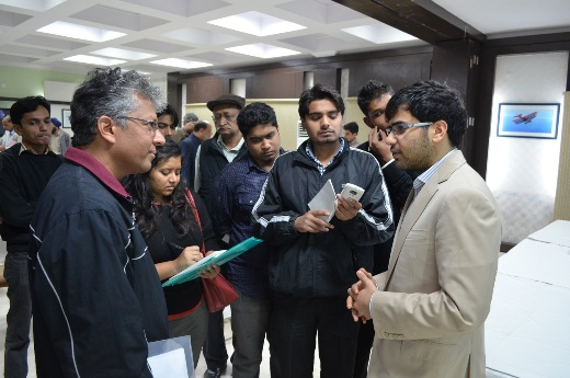 Parimarjan Negi talking to journalists
