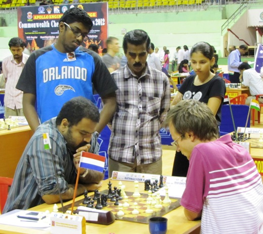 Top board game between Tiviakov and Rathnakaran watched by the trio GM Adhiban, O T Anil Kumar and Shweta Gole