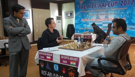 Match between Radoslaw Wojtaszek and Abhijeet Gupta in progress. Sasikrian looks on