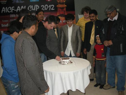 Players celebrating Christmas by cutting the cake