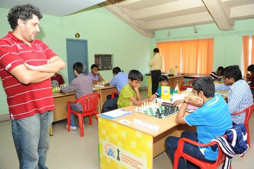 GM Czebe Attila (Hungary) taking a look at FM Aravindh Chithambaram's game