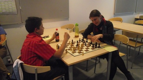 Bharat Arjun and WIM Oksana Vovk analyse their game that ended in a draw