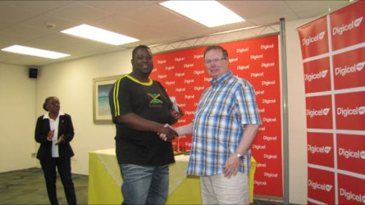 NM Andrew Mellace with David Jarrett as the General Secretary of the Barbados Chess Federation, Ms Hetty Wilson looks on