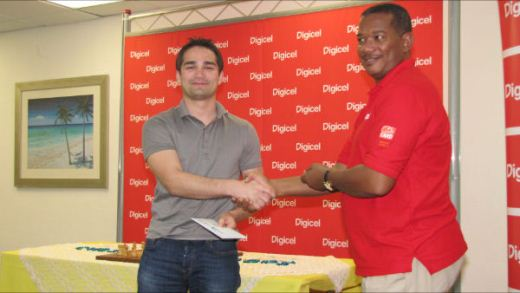GM Mesgen Amanov receiving his award form Alex Tasker of Digicel