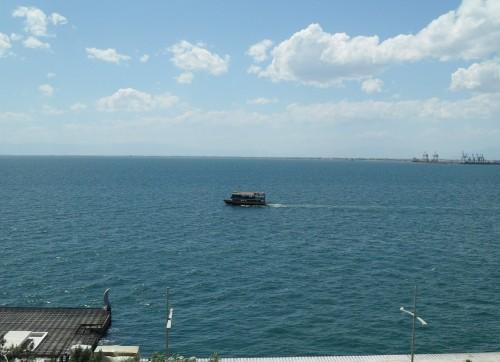 Tourist ferry passing by Makedonia Palace