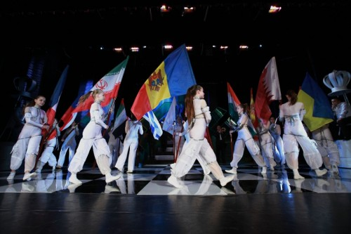 Flags of the participating nations enter the stage