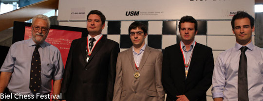 The winners wearing their medals