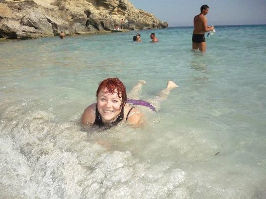 Katarzyna bathing in the sea at Cala Rossa in the wonderful island of Favignana
