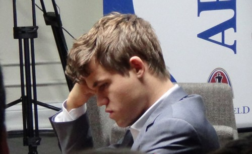 While Carlsen is contemplating his move....
