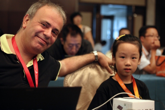 FIDE Supervisor Ali Nihat Yazici and small chess fan
