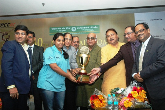 Mary Ann receiving the trophy and a cash prize of Rs.1,75,000 from Mr. PK Bannerjee (centre with spectacles), football Olympian and Honourable minister for Sports Madhan Mitra (next to him with yellow shirt)