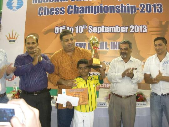 Ram Aravind receiving Winners trophy