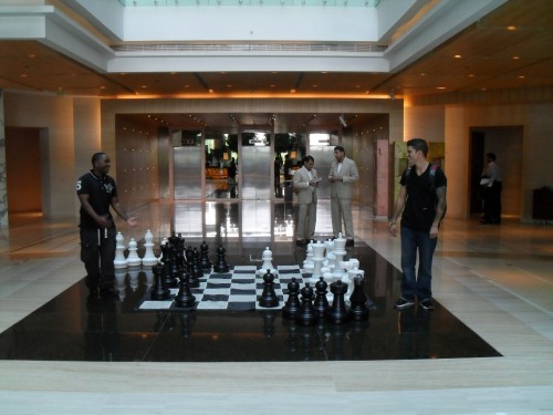 Guests of Hyatt Regency Chennai testing the chess boards in the lobby