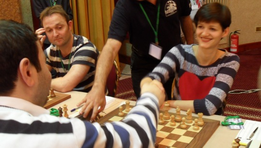 Olga Dolzhikova and Shakhriyar Mamedyarov shaking hands