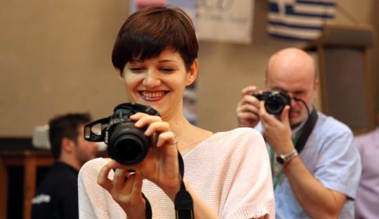 Olga Dolzhikova taking photos