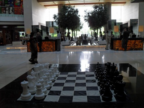The hotel reception area with a large chess board in the middle