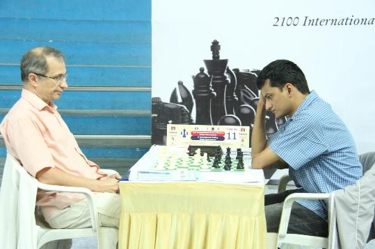 Ukranian Grandmaster Valeriy Neverov in action against IM Praveen Kumar