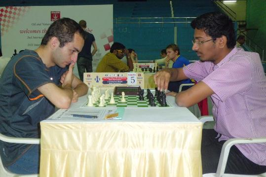 Dhulipala Bala Chandra Prasad going to make his move against Grandmaster Samvel Ter-Sahakyan. Prasad achieved 9 game International Master Norm