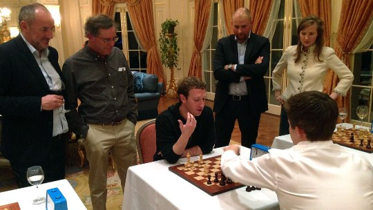 Mark Zuckerberg and Magnus Carlsen playing chess