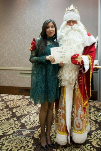 The tournament director WFM Indira Bajt with Santa Claus