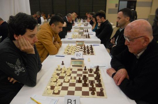 Legendary IM Rajko Bogdanović (r) joint leader in Open B