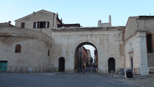 The Roman gate (Augustus' arch), opens to the cobbled streets of the old town of Fano
