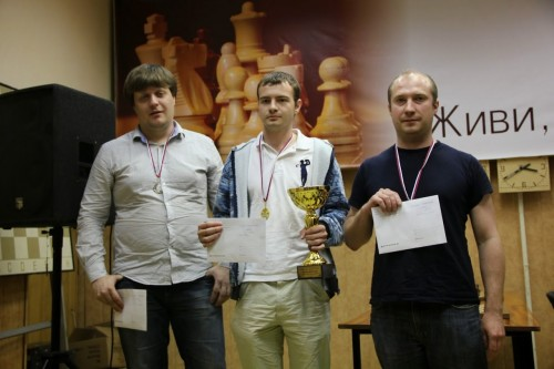 Rapid Chess Tournament winners From left to right: GM Dmitry Bocharov (RUS, Novosibirsk) seems disappointed because he is the second in the second tournament in a row. IM Ivan Rozum holds the winner cup. GM Andrey Deviatkin (RUS, Moscow) declared a year ago his intention not to play classical chess any more, but after his success in rapid tournament you can see him in the Master Open again.
