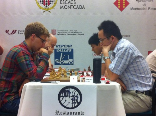 Fixing a draw in the last round, GM Yaroslav Zherebukh and GM Hua Ni shared first place