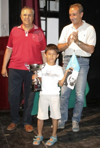 The seven years old  Kazakh child Batyrkhan Muratov winner of Open C (photo by Gianni Gigante)