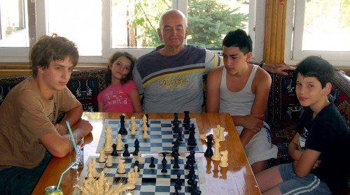 Gideon Japhet playing chess with his grandchildren