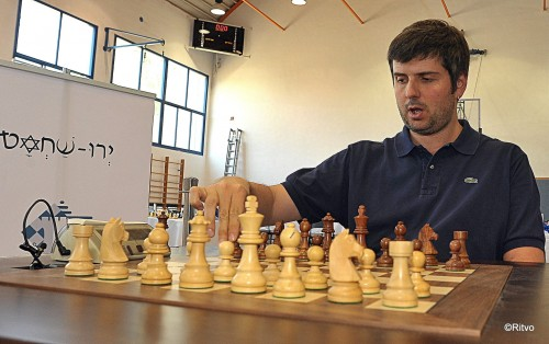 Svidler fine-tunes the pieces prior to starting the game