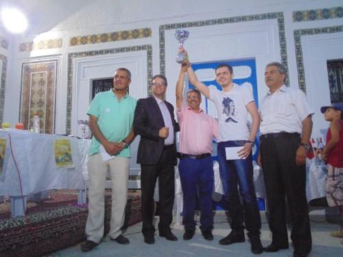 GM Kirill Stupak lifts the trophy